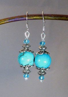 "Brilliant Turquoise ""Gumball"" Stone, Crystal & Silver Drop Earrings, made from re-constructed Turquoise and hand-dyed.    https://www.etsy.com/listing/101265769/turquoise-stone-silver-crystal-gumball"