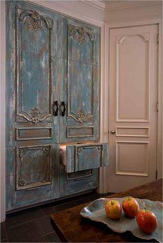 Found my kitchen fridge . Fridge encased in antique Italian painted armoire doors. By architect R. Stephen Chauvin, courtesy of Chauvin Arkhitekton.