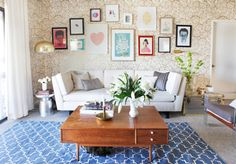 Use rugs to add color and cover ugly carpet. Wall-to-wall carpet is my biggest pet peeve in rentals. Of course, if you can find a place with gorgeous hardwood floors, get it!!! But if you can't, spruce up all that beige blah-ness with a colorful and stylish rug.