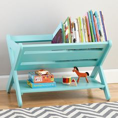 """If your kids are the throw-and-go type, The Land of Nod's """"a href=""""http://www.landofnod.com/good-read-book-caddy-azure/f12250"""">Good Read Book Caddy ($149) is an easy book-storage option, allowing kids easy access to their books — and making it easy for them to reshelve when they're done reading. Available in five colors to match any room."""