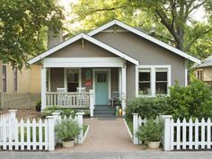 Paint Colorshide  Siding: Sparrow by Benjamin Moore; Trim and fence: Frostine by Benjamin Moore; Front door: Majestic Blue by Benjamin Moore; Corbels: Thicket by Benjamin Moore