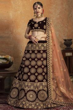 Dark Maroon velvet semi stitch lehenga with velvet choli. This Sweetheart neckline and Short Sleeves clothing designed with Zari, Dori and Stone Work. Product are available in 32 to 58 sizes. It is perfect for Bridal Wear. Ghagra Choli, Lehenga Dupatta, Lehenga Choli Online, Bridal Lehenga Choli, Indian Lehenga, Choli Designs, Lehenga Designs, Salwar Kameez, Lehenga Indien