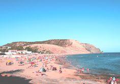 A colourful bay at Pria De Luz beach, Algarve, Portugal.