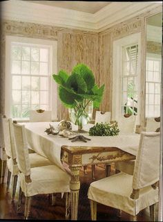 Louis XVI gilded table, slipcovers, silver shells, pecky cypress walls - Amanda Lindroth in Veranda, May-June 2010