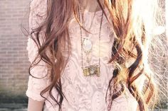 Um. I want this shirt, that necklace, and her HAIR.