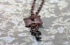 Warehouse 13 Inspired Steampunk Lock Key Necklace in Antique Copper. $22.00, via Etsy.