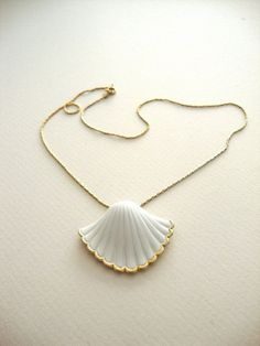 Gold rim sea shell necklace.