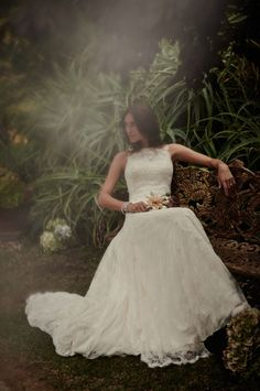 Be lovely in a little (or a lot) of lace with this designer gown from Melissa Sweet.
