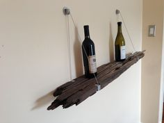 Reclaimed Driftwood Bookshelf with Steel Cable Supports. $75.00, via Etsy.