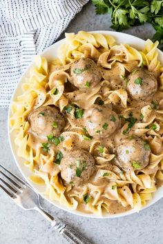 The Best Swedish Meatballs and Gravy are made with a combination of ground pork and beef and spiced to perfection for a flavorful meatball and with a rich and flavorful gravy to go with it!