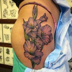 purple gladiolus flowers on hip.