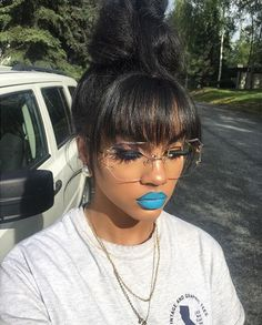 She is so beautiful lose the glasses and lose the blue lips