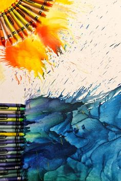 This is actually easier than it looks.  Glue crayons to a piece of cardboard or to the a canvas.  Then get a blow dryer, tunr it on, and hold at an angle.  The crayon will start to melt and drip in the direction of the hot air.  Put cardboard behind the art piece, the crayon will splatter.  You can also do this by placing the art outside if it is over 100 degrees.