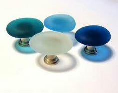 Coloured glass knobs. Have a different colour on each drawer??