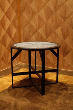 A coffee table byJean-Michel Frank. The material used is oak wood and aluminium. The aluminium  painted into dark brown color.