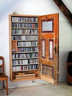 CD storage behind an old door- I freakin adore this!!!