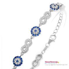 Nazar Boncuklu Sonsuzluk Gümüş Bileklik - Şeffaf ve mavi renkli zirkon taşların ışıltısı ile göz kamaştırıcı sonsuzluk bileklik. 925 ayar gümüş. Nazar Boncuğu Resimleri
