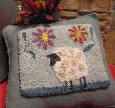 Primitive Punch Needle Pattern Zinnia. This little woolie sheep is complemented my two giant zinnias. The design is drawn on weavers cloth and measures approximately 4.5 x 3.5 Pattern includes color photo on front cover, an instruction sheet, and list of threads needed on back