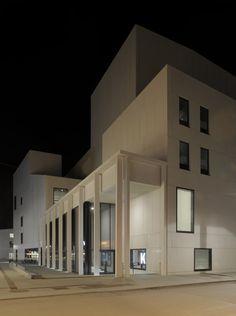 This white concrete cultural centre nestles up against a Norwegian harbour.
