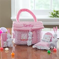 """Personalized Easter Bunny Cottage Playset by PersonalizationMall.com. $36.95. Make """"somebunny"""" feel extra special with our Embroidered Cottontail Cottage by personalizing any name in hot pink thread on the light pink and white striped upholstered roof!House comes complete with soft sculpture miniature pink chair and bed along with a mommy, daddy and little bunny.All parts are made of poly-cotton with handle for easy carrying. House measures 7""""L x 5""""H x 4""""D and bunnie..."""