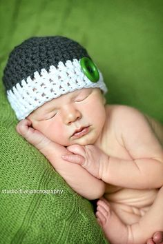 Baby boy hat. Adorable crochet beanie, that is custom made especially for you! You pick the colors and the size. This beanie can be made with or without the button. This listing is for the dark gray and white, with a green button. The additional pictures are to show other views of
