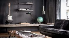 such a wonderful 150 sqm flat for rent in Berlin...dark colors against wood and design items