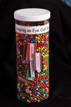 Vocabulator for: Keeping an Eye Out for Similes. The tube is filled with beads, rubber eyeballs, and similes.