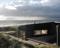 Black house on the beach front