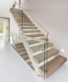 Simple and Modern Staircase Design Ideas (Best for Home and Office) - JJones Glass Stairs Design, Stair Railing Design, Home Stairs Design, Interior Stairs, Glass Stair Railing, Glass Handrail, Stairs With Glass Balustrade, Staircase Design Modern, Modern Stair Railing