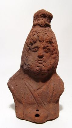Roman Egyptian terracotta figural bust of Serapis, Roman Egypt, 3rd century A.D. Draped and wearing a modius, his features rather forlorn, 19 cm high. Private collection