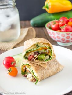 Greek Veggie Hummus Wrap has all the veggies you need for a Greek salad wrapped in a whole wheat tortilla with creamy hummus. It& hearty and satisfying! Vegetarian Wraps, Vegetarian Recipes, Healthy Recipes, Delicious Recipes, Vegetarian Sandwiches, Going Vegetarian, Vegetarian Breakfast, Vegetarian Dinners, Fast Recipes