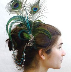 I love the dangles on this one. I'm not sure I have the style to pull off such a tall feathered headpiece but I love love love the dangles.