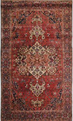 Persian Sarouk Fereghan rug, The madder field with a central pendant medallion is within an indigo rosette border. 6 feet 6 inches x 4 feet 2 inches.