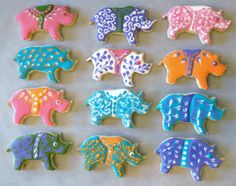 A Crash of Rhinos, Flood Icing, Piped Icing, and Sanding Sugar on Butter Cookies.