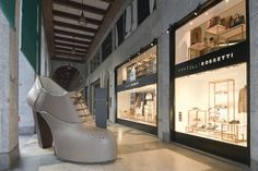 The 3 Rossetti brothers Diego, Dario and Luca have brought a larger than life scale shoe to Montenapoleone at the Fratelli Rossetti store, to celebrate Milan Fashion Week.