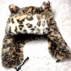Leopard Fur Hat Gorgeous faux fur leopard hat with strap. It is VERY warm. I adore this hat but I never wear it because it makes me too hot.   ✅ Bundle and save on shipping! ✅ All reasonable offers are considered.  ✅ I always ship right away.  ❌ Trades ❌ Lowballing Accessories Hats
