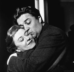Federico Fellini kissing his wife Giulietta Masina, on the set of La strada. 1954