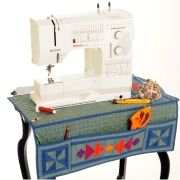 Sewing Machine Station Mat - Free PDF Pattern. Looks easy enough to make without a pattern. I would like a tape measure on it as we'll.