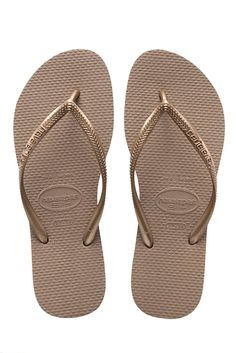 The Havaianas Slim features a sleek slim strap and Havaianas logo with their signature textured footbed that provides style and comfort. Goes with every bikini!