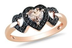 What looks like a lightly colored champagne, heart-shaped diamond set with round, brilliant cut black diamonds. Twotone