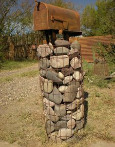 Wire #stone #mailbox post filled with rocks/stone. This way neat…