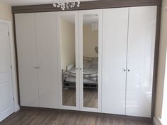 Fitted wardrobes with external mirrors in Cashmere gloss. Fitted Bedrooms, Fitted Wardrobes, Bespoke Furniture, Mirrors, Tall Cabinet Storage, Cashmere, New Homes, Luxury, Fitness