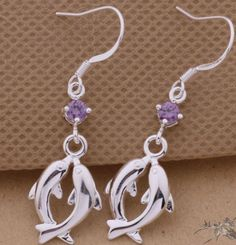 925 Silver Infinity Dolphin Earring Price $14.99