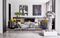 A sterling silver Takashi Murakami sculpture stands between the two sections of the living room.