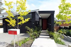 Literarywondrous Red Door decorating ideas for Beguiling Exterior Contemporary design ideas with black exterior black garage door Black siding bushes butterfly roof clerestory window