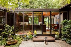 all black home + wall of windows : mid century modern : cin at sea