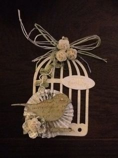 Birthday tag using Tim Holtz bird cage and rosette dies..