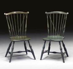 "A PAIR OF GREEN PAINTED WINDSOR BRACEBACK SIDE CHAIRS   NEW ENGLAND, LATE 18TH CENTURY   Plank seats stamped ""SK""   36 ½in. high (2)"