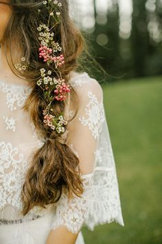 Step up your braid game by adding fresh flower to your wedding 'do.