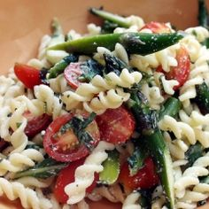 Pasta Salad with Asparagus, Basil, and Grape Tomatoes Recipe  INGREDIENTS  1 pound fusilli   Sea salt and freshly ground black pepper, to taste   One 6-ounce container nonfat Greek yogurt   1/2 cup olive oil   1 tablespoon white balsamic vinegar   1 pint grape tomatoes, halved